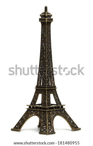 Close up view of a small Eiffel tower statue isolated on a white background.