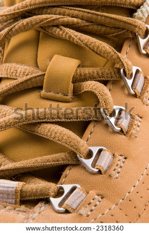 Close up view of a soft leather walking shoe, showing laces in detail. - stock photo
