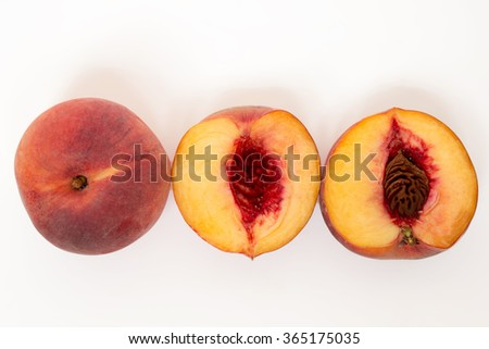 Close up view of a sweet peach sliced isolated on a white background.