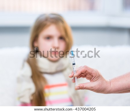 Close up view of a syringe with a child at the background - stock photo