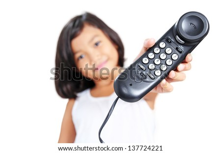 Close up view of a telephone from a young girl. - stock photo