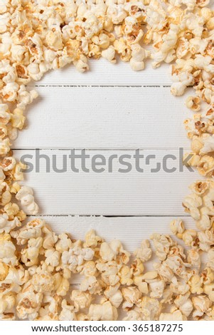 Close up view of a texture background with sweet and tasty popcorn with copyspace. - stock photo