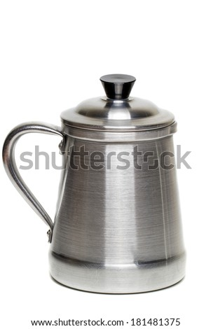 Close up view of a vintage aluminum coffee maker cup isolated on a white background.