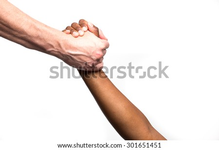 Close up view of a white / caucasian male gripping a black / african / colourd womans hands in an uplifting gesture - stock photo