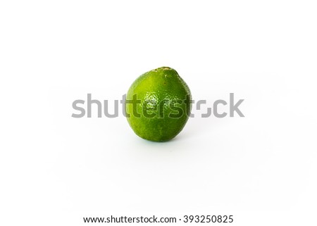 Close-up view of a whole fresh green organic raw lemon isolated on white background with clipping path.