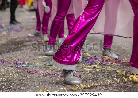 Close up view of a woman's legs in a Carnival parade.