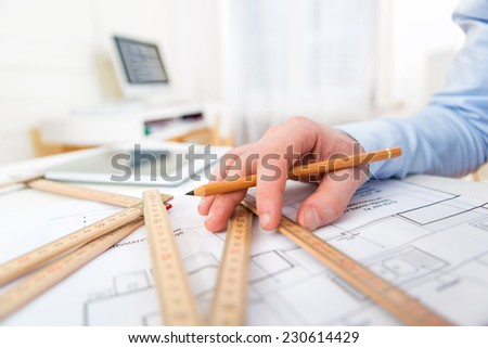 Close up view of an architect working at the office - stock photo
