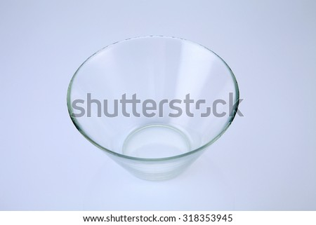 Close up view of an empty salad bowl isolated on a white background.