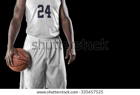 Close up view of Basketball Player on a black background - stock photo
