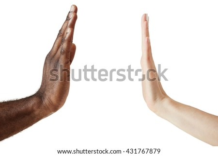 Close up view of black male and white female hands giving a five isolated against white studio wall, symbolizing multicultural cooperation and interracial friendship. Peace and unity against racism. - stock photo