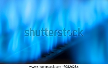 Close-up view of blue flames in gas boiler - stock photo