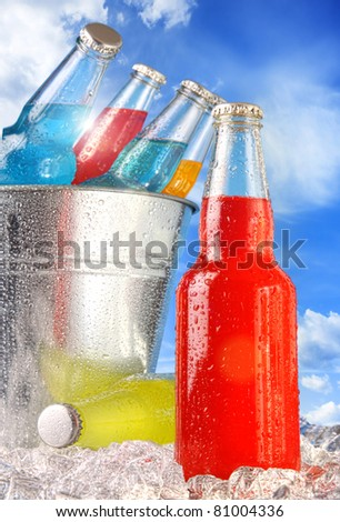 Close-up view of bottles with ice against blue sky - stock photo
