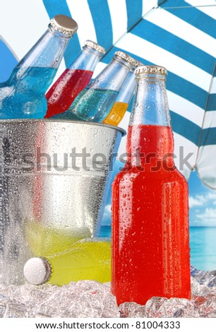 Close-up view of bottles with ice at the beach - stock photo