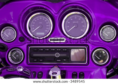 Close-up view of bright purple motorcycle dashboard - stock photo