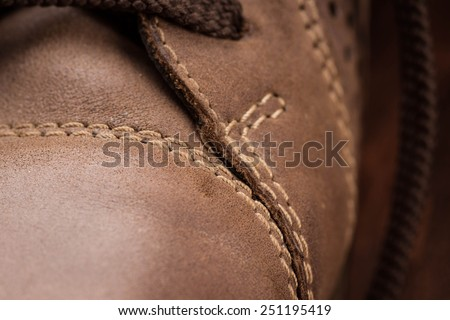 Close up view of brown boot with laces - stock photo