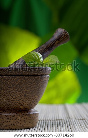 Close up view of  brown mortar with ingredients inside - stock photo