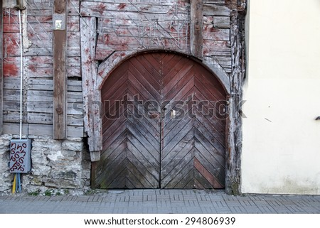 Close up view of brown wooden door of the old red or brown wooden building.