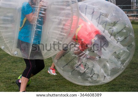Close up view of bubble football balls game. - stock photo