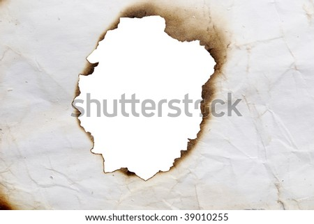 close up view of burnt hole in a paper