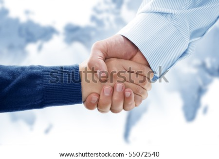 Close up view of business people handshake in office environmeny - stock photo
