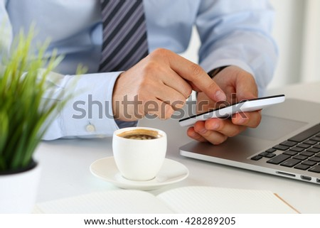Close up view of businessman hands holding smart phone. Mobile applications, playing games, social media, organizing work, online banking or purchase concept. - stock photo