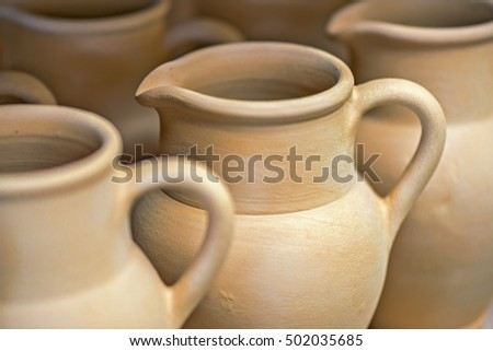 Close-up view of ceramic dishware in pottery workshop