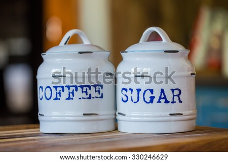Close up view of Coffee and Sugar pots on a table in a kitchen.