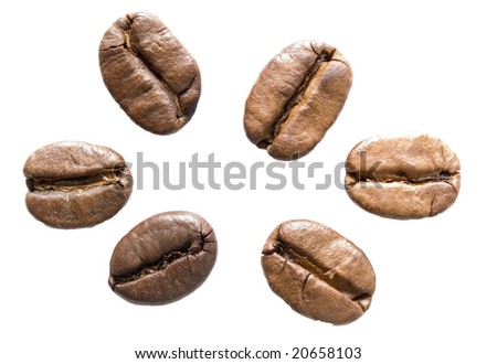close up view of coffee beans isolated on white
