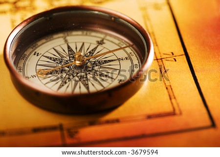 Close up view of compass on old map - stock photo