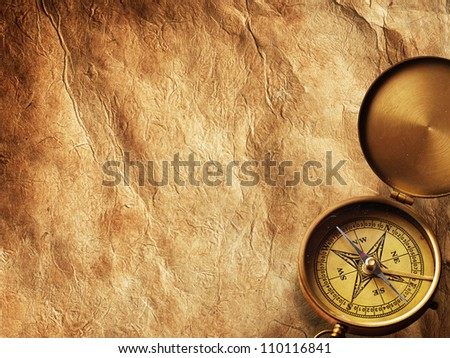 Close up view of compass on vintage paper - stock photo
