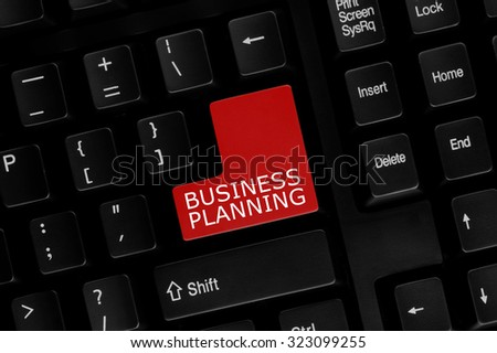 Close-up view of computer keyboard with Business Planning words on keyboard button. - stock photo