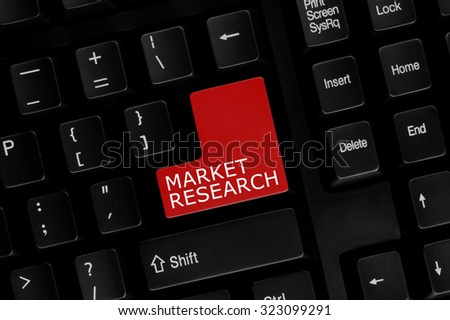 Close-up view of computer keyboard with Market Research words on keyboard button. - stock photo