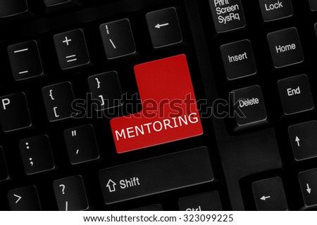 Close-up view of computer keyboard with Mentoring word on keyboard button. - stock photo