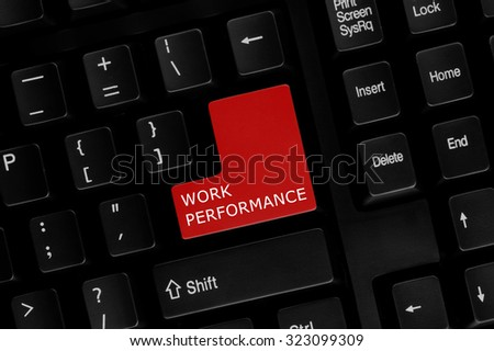 Close-up view of computer keyboard with Work Performance words on keyboard button. - stock photo