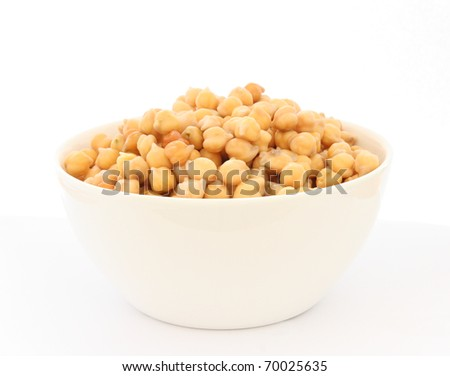Close up view of cooked chickpea in bowl on white background - stock photo