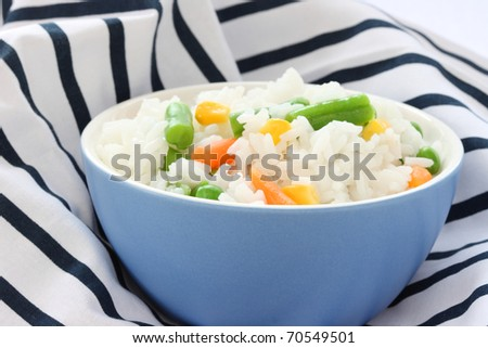 Close up view of cooked rice in blue bowl - with mixed of colorful vegetable - stock photo