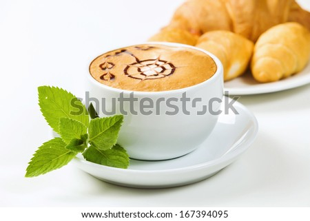 Close up view of cup of coffee with ornament - stock photo