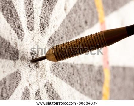 Close-up view of darts in bullseye on dartboard - stock photo