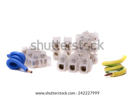 Close up view of electrical plugs and copper wire cables isolated on a white background. - stock photo