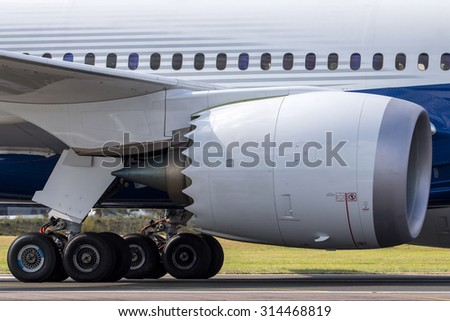 Close up view of engine and landing gear of a commercial airliner - stock photo