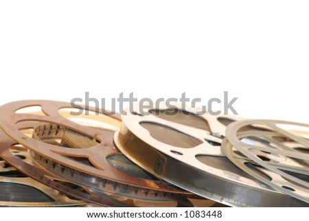 Close up view of film reels - metal and plastic with film on them. - stock photo