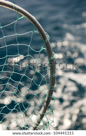 Close up view of fishing net over the water - stock photo