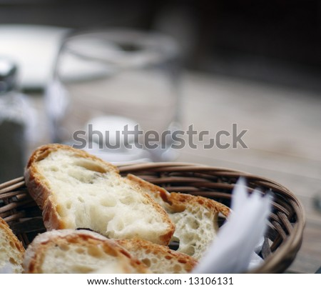 Close up view of fresh crusty bread in a basket - stock photo
