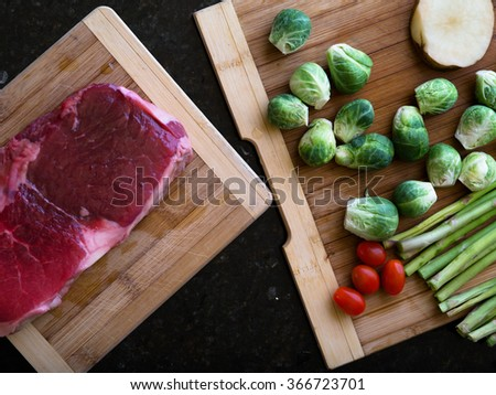 close up view of fresh piece of meat with some vegetables on the back - stock photo
