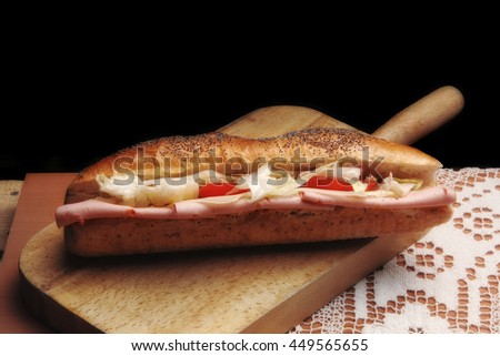 close up view of fresh salami sandwich