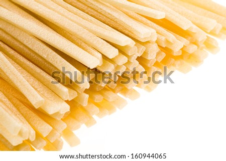 Close up view of freshly made linguine pasta on a white background. - stock photo