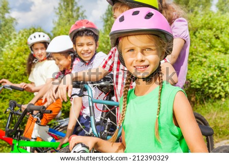 Close up view of girl in helmet and her friends - stock photo