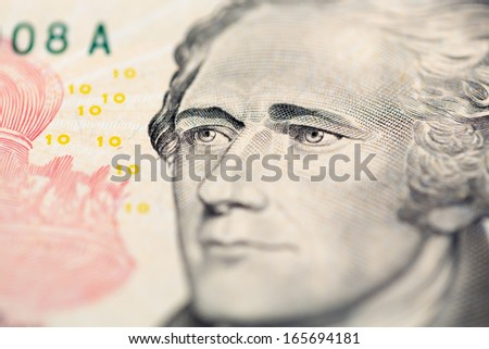 Close up view of Hamilton's portrait on the ten dollars note - stock photo