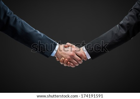 Close up view of hand shake of business people. Concept of trustworthy relations and business cooperation - stock photo