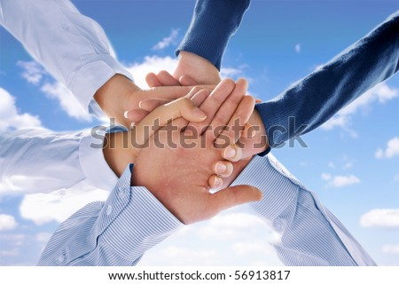 Close up view of hands getting together  on blue background